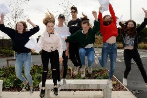 Archive photo from GCSE results day 2018 - students at the Sir Thomas Fremantle School in Winslow jump in celebration!