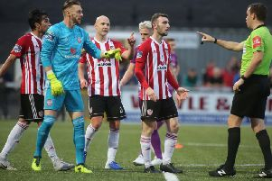 Derry players remonstrate with Robert Harvey during the extra.ie FAI Cup second round clash against Dundalk at Brandywell.