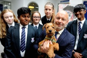 Felpham Community College's new school dog, Margot, with headteacher Mark Anstiss and students. Picture: Kate Shemilt - ks190496-2