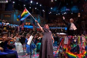 Jamie Barton, the bisexual American mezzo-soprano waves an LGBT rainbow flag during the annual rendition of Rule Britannia at Last Night of the Proms at the Royal Albert Hall, Saturday September 14 2019. Some people like to lampoon the nationalist spirit of Last Night in various good humoured ways, but in Northern Ireland Proms In The Park audiences don't even get the chance, with much of the nationalist good fun edited out, in an event that has almost no relationship to Last Night. Screengrab from BBC One