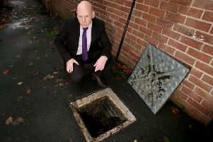 Holy Cross Boys' Primary School principal Kevin McAreavey at the drain where the weapon was found