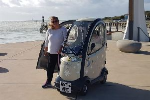 Tara Roberts out in Littlehampton with her mobility scooter