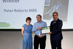 Peter Roberts MBE receiving the ACoRP Lifetime Achievement Award from ACoRP chief executive, Jools Townsend (left) and managing director of West Midlands Trains, Jan Chaudhry van der Velde (right). EMN-190410-174410001