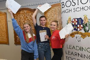 Savannah Hicks 17, Kitty Hooper 18, Bryony Smith 18, celebrate at Boston High School