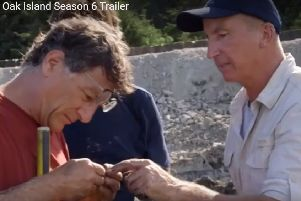Gary Drayton hands his 'gold' find to Marty Lagina in the trailer to season six of Curse of Oak Island.
