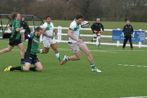 Joe Wilde on the way to touching down one of his five tries against Heathfield & Waldron. Picture by Clive Turner