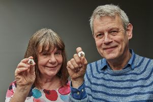 Julia Donaldson and Axel Scheffer with The Royal Mint's Gruffalo coin. SUS-190218-110432001