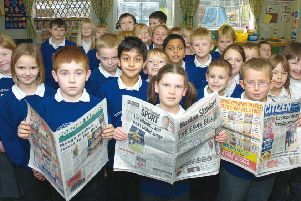 Read all about it! Some of the youngsters get to grips with the Boston Standard, the Poacher Express and The Citizen 10 years ago.