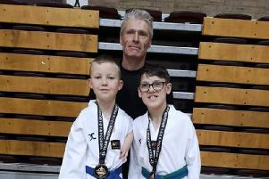 Tyler and Bradley are pictured with coach Jason.
