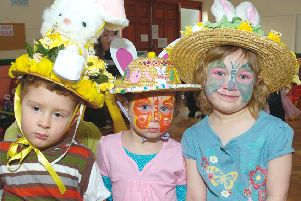 Three toddlers in their easter bonnets.