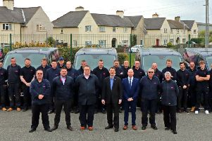 LHP chief executive Murray Macdonald (front centre) joins colleagues and members of the Boston area team, displaying the newly-liveried vans.