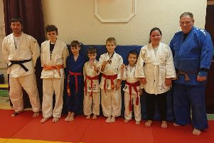 The judo competitors with clubmates.