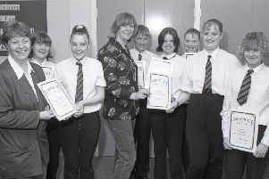 Here we see pupils at Haven High in 1999, receiving certificates after taking part in the Compact Plus scheme. The programme was developed by the Youth Service to develop a range of skills and included for the youngsters a 16-mile all-night hike.