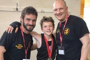 Harvey pictured with coach Tommy Upsall and dad/coach Scott Harmon.