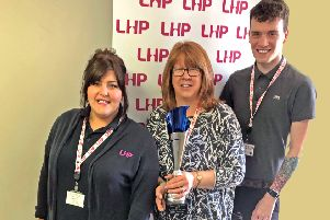 Tizzie Wyles, Debbie Broadley, and Kai Kirman from LHP, with the organisation's Partner of the Year award.