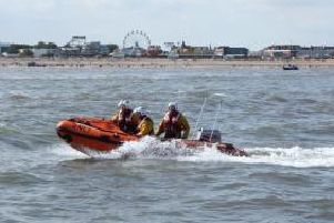The RNLI  inshore lifeboat was launched after  reports of an inflatable dinghy being blown out to sea with two people on board.