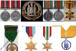 A collection of distinctive WWII medals similar to these was stolen from a Northamptonshire home.
