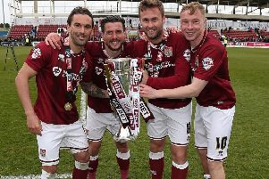 Nicky Adams (far right) celebrates the Cobbleres' 2016 title success, with Ricky Holmes, David Buchanan and Joel Byrom