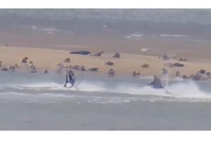 The two men on jet skis racing around the seal colony at Gibraltar Point, Skegness.
