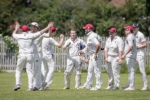 Oakfield & Rowlands 1st team celebrate the fall of a Bablake wicket