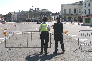 Deserted - Officers make sure the Market Place is kept clear while bomb disposal experts look at the 'suspicious package'.