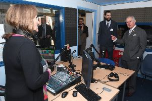 The Prince of Wales during a visit to Endeavour FM last year, with Dylan Taylor, managing director to his left.
