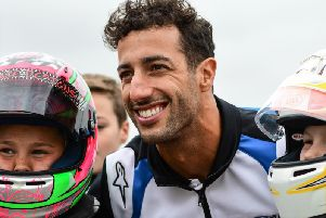 Formula 1 driver Daniel Ricciardo with two young racers at Whilton Mill karting track near Daventry. Photo: James Fitchew Photography