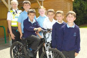 Police Community Support Officer Jayne Richardson with, from left, Thomas Grooby, 11, Daisy Davison, 10, Jordan Seal, 10, Luke Edwards 10, Joe Irving, 10, and Callum Grooby, nine, on his bike.