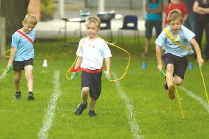 Pictured in the skipping race, from left, Harry Edwards, Adam Good and Kian Mothers.