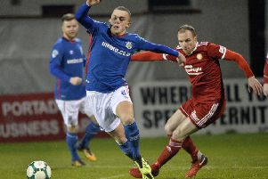 Gregg Hall (right) competing for Portadown against Linfield last season. Pic by INPHO.