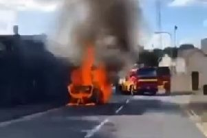 A screen grab from the video posted on the Banbridge Saints and Sinners Facebook page showing firefighters arriving at the scene of the blaze in Dromore.