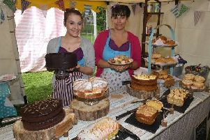 Eleanor Hurrell and Charlotte Hurrell serving tea and cakes at last year's festival