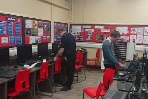 Working on the computer system at Haven High