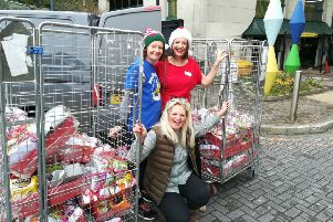 Louise Bartha, Lucy Pond and Caroline Davenport Potter delivering Christmas hampers to the Royal Alexandra Hospital in Brighton SUS-190901-165400001