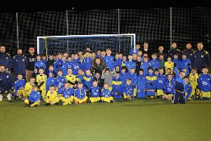 Solly March (centre) lines up with the Flair Academy footballers