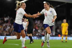 Fran Kirby and Toni Duggan celebrate an England goal in their friendly with Australia in October. Picture by Rob Newell (CameraSport via Getty Images)