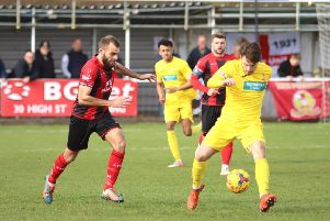 Banbury United's Giorgio Rasulo comes away with the ball at Kettering Town. Photo: Peter Short
