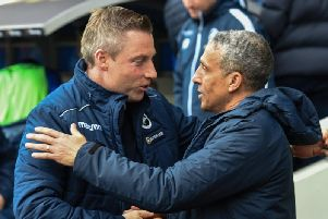 Millwall manager Neil Harris (left) and Brighton & Hove Albion boss Chris Hughton. Picture by PW Sporting Photography.