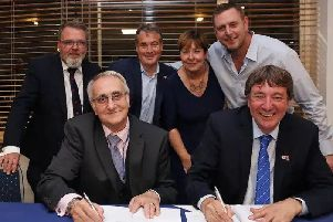 Peterborough United owners and Peterborough City Council officials sign the Memorandum of Understanding. Front row, left to right, Cllr John Holdich, Dr Jason Neale, back, Cllr David Seaton, Stewart 'Randy' Thompson, PCC chief executive Gillian Beasley, Darragh MacAnthony. Photo: Joe Dent/theposh.com.