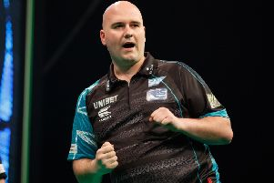 Rob Cross is sitting proudly on top of the Unibet Premier League after night seven in Berlin. Picture courtesy Steve Welsh/PDC