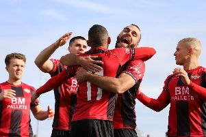 Rhys Hoenes takes the congratulations after he scored Kettering Town's first goal from the penalty spot to send them on their way to a 2-0 success over St Neots Town. Pictures by Peter Short