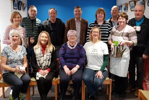 Paul Girvan MP and Trevor Clarke MLA pictured with members of Tildarg Cultural Society and a representative of the Mae Murray Foundation.