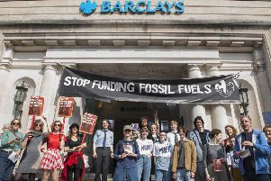 Activists from Brighton Extinction Rebellion stage a 'Fete of the World' outside the branch of Barclays Bank, North St Brighton'Photography www.DFphotography.co.uk