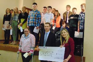 Club leader Sarah Lyness and treasurer Paul Thompson presenting representative from The Cancer Fund for Children with the cheque raised by Lylehill YFC over the past year