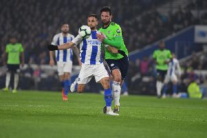 Florin Andone (left) and Sean Morrison battle for the ball in tonight's game between Brighton & Hove Albion and Cardiff City. Picture by PW Sporting Photography.