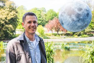 Luke Jerram with his Museum of the Moon (Credit: Summer Dean/Brighton Festival)