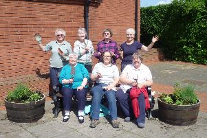 Ruskington WI president Christine Casey and fellow members who helped to plant the commemorative flower barrell on their group's centenary. EMN-190521-104833001