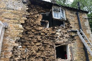 The damage on the outside of the fallen-down wall