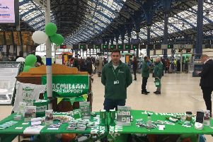 Josh Munns, who was running a stall for Macmillan in Brighton station