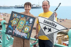 MP for Brighton Caroline Lucas and artistic director of Same Sky John Varah with a copy of the stamp. Photograph: Tony Kershaw/ SWNS